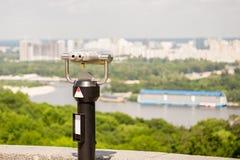 Stationary observation binoculars , metropolis landscape on the Royalty Free Stock Photos