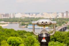 Stationary observation binoculars , metropolis landscape on the Stock Photo