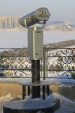Stationary panoramic binoculars in the winter city. Modern architecture and tourism Royalty Free Stock Images