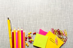 Stationary in pink and yellow color. With copy space Royalty Free Stock Photo