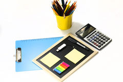 Stationary set on white background. Clipboard, black board, caculator and pen isolated on white background Stock Image