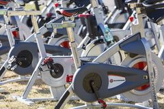Stationary spinning bikes rows Royalty Free Stock Images