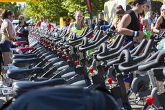 Stationary spinning bikes rows Stock Images