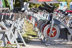 Stationary spinning bikes rows Royalty Free Stock Image