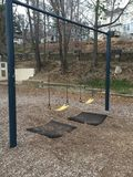 Stationary Swings Just Waiting For Kids Royalty Free Stock Photography