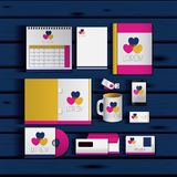 Stationary templates of documentation romantic date design of business stationery over blue wooden background. Vector illustration Stock Photos