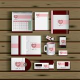 Stationary templates of documentation romantic date design of business stationery over wooden background. Vector illustration Stock Images