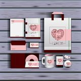 Stationary templates of documentation romantic date design of business stationery over wooden background. Vector illustration Royalty Free Stock Images
