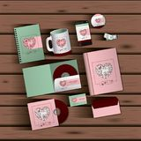 Stationary templates of documentation romantic date design of business stationery over wooden background. Vector illustration Royalty Free Stock Photography