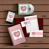 Stationary templates of documentation romantic date design of business stationery over wooden background. Vector illustration royalty free illustration
