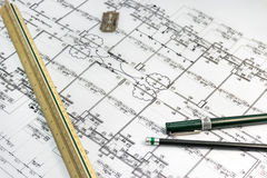 Stationary tools with architect plan document as a background Stock Photo