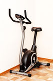 Stationary training bicycle Stock Photography