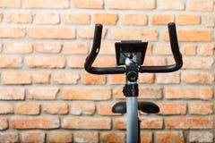 Stationary training bicycle indoors Royalty Free Stock Photo