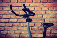 Stationary training bicycle indoors Royalty Free Stock Photography