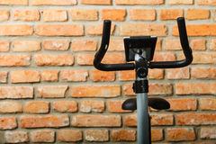 Stationary training bicycle indoors Royalty Free Stock Image