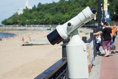 Stationary viewing binoculars on the embankment of the Amur rive Royalty Free Stock Photo