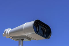 Stationary viewing binoculars. Stationary binoculars are placed against the blue sky Stock Photo