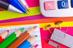 Stationeries. On a background the coloured paper Stock Images