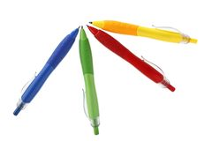Stationery. Red, green, blue and yellow pens isolated on white background Royalty Free Stock Image