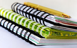 Stationery. Three spiral notebooks with pen on the table Stock Photography