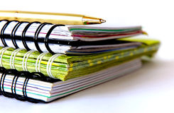Stationery. Three spiral notebooks with pen on the table Royalty Free Stock Photography