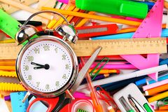 Stationery and alarm clock. Royalty Free Stock Image