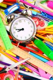 Stationery and alarm clock. Royalty Free Stock Photos