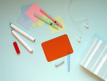 The stationery on a blue background. stock image