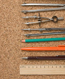 Stationery on the board. Stationery on the cork board Royalty Free Stock Image