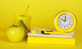 Stationery, books and apple Stock Photo