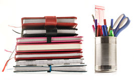 Stationery and books on white background Stock Images