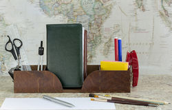 Stationery. Box office supplies on world map background stock photography