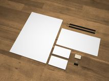 Stationery branding mock-up 3D illustration on wooden background. Branding mock-up template on wooden background. Set of brand stationery mockup with an A4 Stock Photography