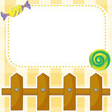 A stationery with candies and wooden fence Stock Image