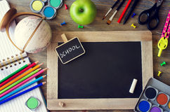 Stationery with chalk board and terrestrial globe. back to schoo. Stationery with chalk board, terrestrial globe, pencils and paints back to school and learning royalty free stock images