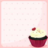 A stationery with a chocolate cupcake with a heart Stock Photos