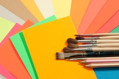 Stationery on colored papers Royalty Free Stock Image