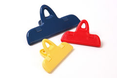 Stationery colorful clips on a white background Royalty Free Stock Photos