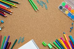 Stationery on cork board. Concept back to school. Place for your text. Stationery on cork board. Concept back to school. Place for your text royalty free stock image