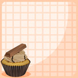 A stationery with a cupcake with chocolate toppings Royalty Free Stock Images