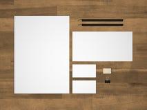 Stationery 3D illustration branding mock-up with letterhead on wood. Branding mock-up on wood background. Branding stationery mockup with an A4 letterhead Royalty Free Stock Image