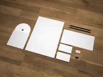 Stationery 3D illustration branding mock-up on wood. Branding mock-up on wooden background. Set of brand stationery mockup with an A4 letterhead, business cards Stock Image