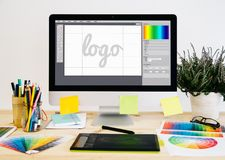 Stationery desktop logo design. Stationery desktop with design stuff, computer and graphic tablet. Logo design royalty free stock photography