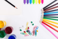 Stationery and drawing tools. Colorful pencils, gouache paint, stickers, clips and pins on white background. Mock up Royalty Free Stock Images