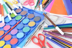 Stationery facilities. Box with new watercolor paints, notebooks and other stationery facilities Stock Image
