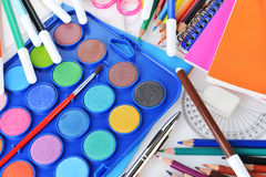 Stationery facilities. Box with new watercolor paints, notebooks and other stationery facilities Royalty Free Stock Image