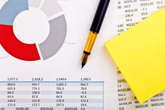 Stationery and financial documents with charts Stock Images