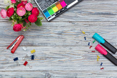 Stationery, flowers and laptop Royalty Free Stock Photo
