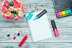 Stationery, flowers and notepad Stock Photos