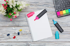 Stationery, flowers and notepad Royalty Free Stock Photos